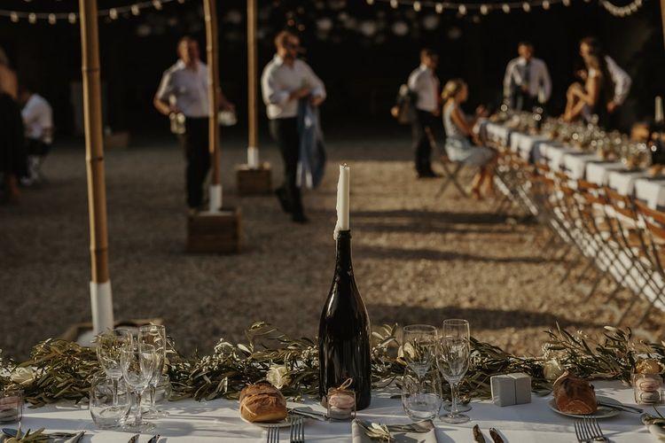 Bottle & Candle Table Decor | Outdoor Destination Wedding at Château de Saint Martory in France Planned by Senses Events | Danelle Bohane Photography | Matthias Guerin Films