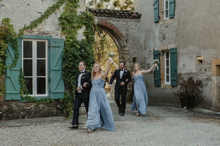 Wedding Party Entrance | Outdoor Destination Wedding at Château de Saint Martory in France Planned by Senses Events | Danelle Bohane Photography | Matthias Guerin Films