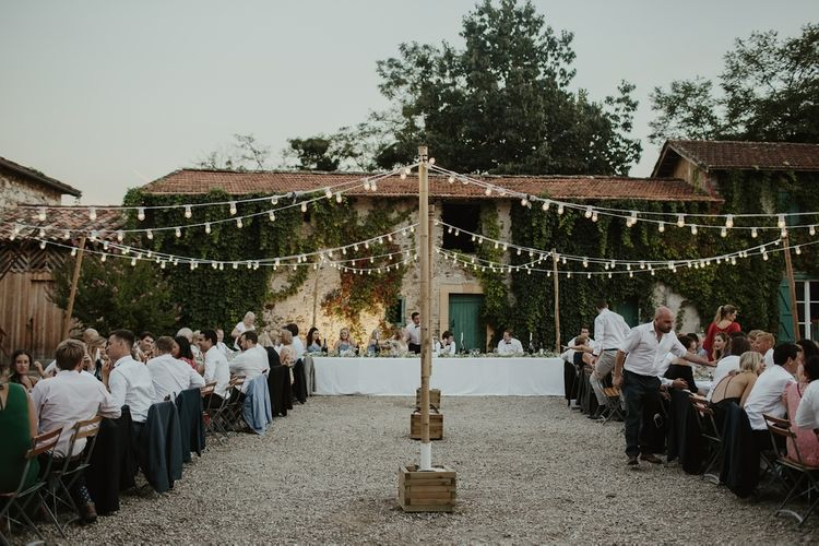 Festoon Lights | Alfresco Reception | Outdoor Destination Wedding at Château de Saint Martory in France Planned by Senses Events | Danelle Bohane Photography | Matthias Guerin Films