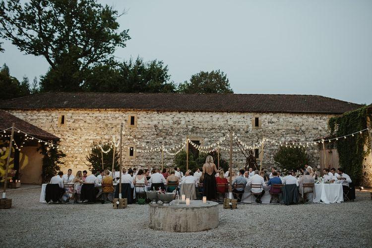 Al Fresco Reception with Festoon Lights | Outdoor Destination Wedding at Château de Saint Martory in France Planned by Senses Events | Danelle Bohane Photography | Matthias Guerin Films