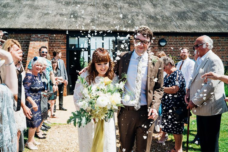 Confetti Exit | Bride in Lucy Can't Dance Jungle Fever Bridal Gown | Groom in Brown Next Suit | Bohemian Wedding at Woodfarm Barn, Suffolk | The Steed Photography