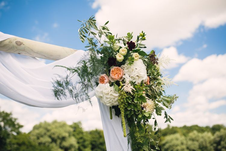 Draped Wedding Altar with Peach Flowers