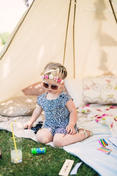 Cute Toddler with Heart Sunglasses & Flower in her Hair