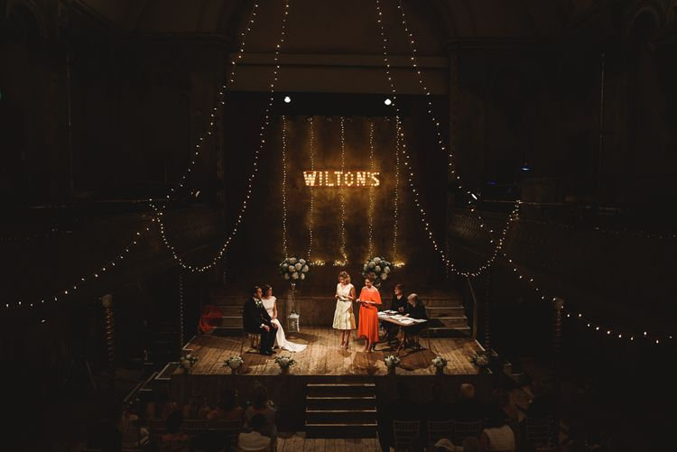 Wiltons Music Hall Wedding With Bride In Paloma Blanca And Bridesmaids In Sequinned Adrianna Papell Gowns Images By Jackson & Co Photography