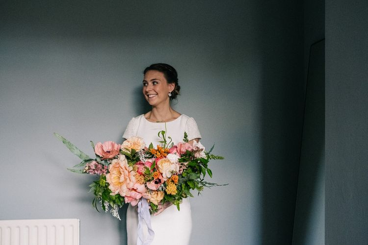 Bride in Bespoke Gown | Oversized Peach Bridal Bouquet | Peach & Mint Intimate Wedding Ceremony at the Asylum & Art Deco Reception at Brockwell Lido, London | Babb Photo