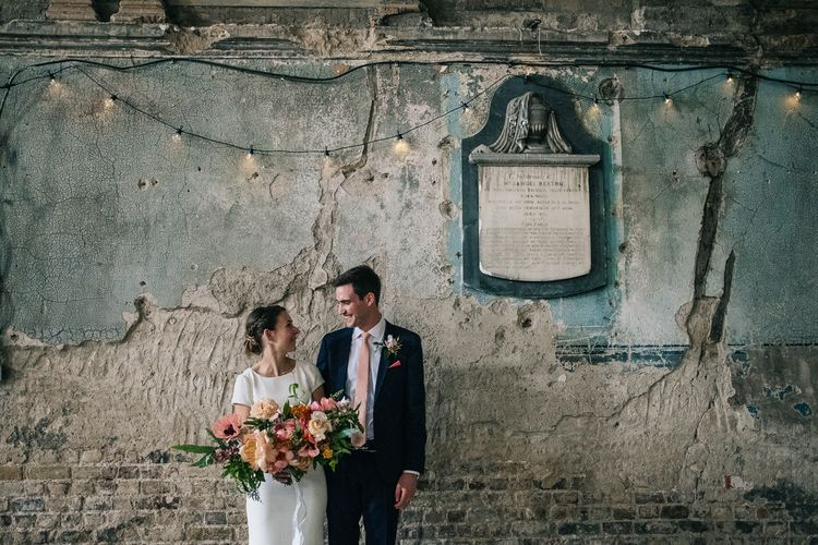 Bride in Bespoke Gown | Oversized Bouquet | Groom in Black Suit & Peach Tie | Peach & Mint Intimate Wedding Ceremony at the Asylum & Art Deco Reception at Brockwell Lido, London | Babb Photo