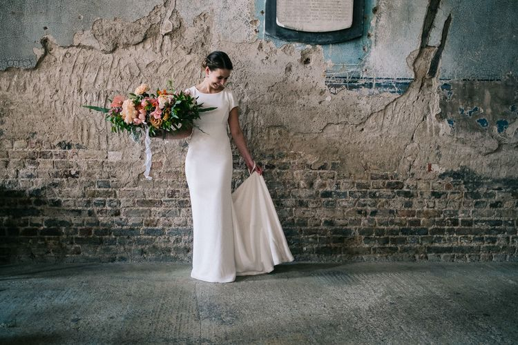 Bride in Bespoke Gown | Peach Oversized Bridal Bouquet | Peach & Mint Intimate Wedding Ceremony at the Asylum & Art Deco Reception at Brockwell Lido, London | Babb Photo
