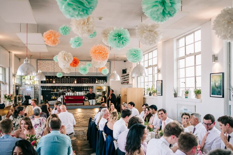 Hanging Paper Pom Poms | Peach & Mint Intimate Wedding Ceremony at the Asylum & Art Deco Reception at Brockwell Lido, London | Babb Photo