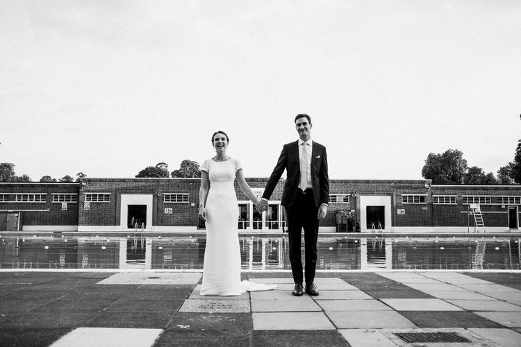Bride in Bespoke Gown | Groom in Black Suit | Peach & Mint Intimate Wedding Ceremony at the Asylum & Art Deco Reception at Brockwell Lido, London | Babb Photo