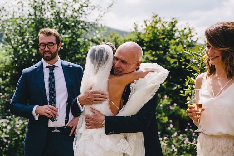 Father of the Bride hugs