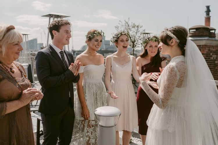 Bridesmaids wear individual dresses   Hoxton Hotel Wedding   Images by Millar Cole