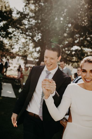 Wedding Ceremony | Bride in Houghton NYC Bridal Gown | Groom in Armani Suit | Stylish Outdoor Wedding at The Oaks Estate, Greyton, South Africa | Fiona Clair Photography | Ebert Steyn Films