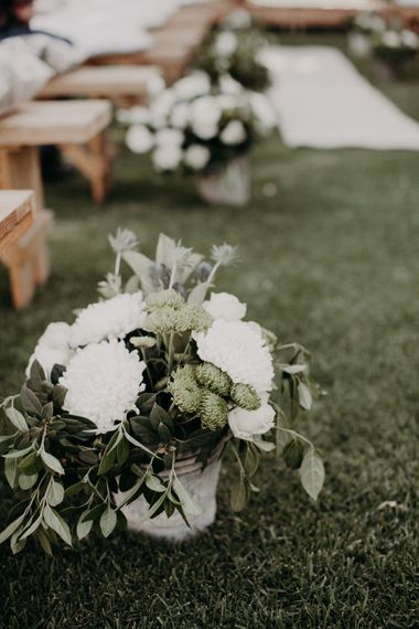 White Wedding Flowers in Bucket Lining the Aisle | Stylish Outdoor Wedding at The Oaks Estate, Greyton, South Africa | Fiona Clair Photography | Ebert Steyn Films