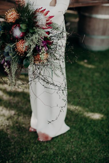 Protea Wedding Bouquet | Bride in Houghton NYC Bridal Gown | Stylish Outdoor Wedding at The Oaks Estate, Greyton, South Africa | Fiona Clair Photography | Ebert Steyn Films