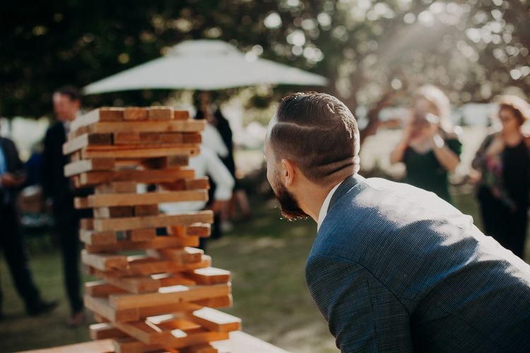 Giant Jenga Garden Games | Stylish Outdoor Wedding at The Oaks Estate, Greyton, South Africa | Fiona Clair Photography | Ebert Steyn Films