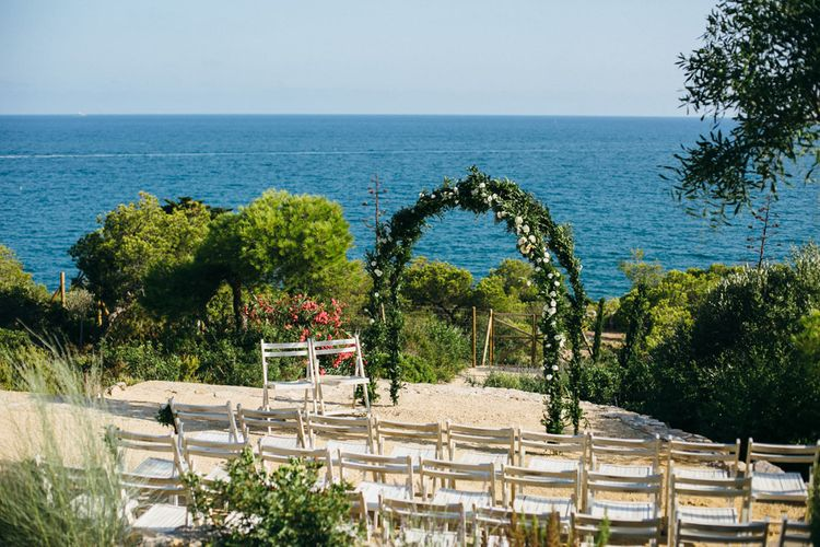 Outdoor Wedding Ceremony with Floral Arch at Casa del Mar Spanish Villa