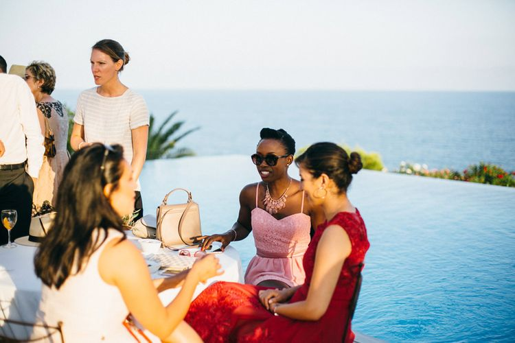 Wedding Guests around Infinity Pool at Casa del Mar Spanish Villa