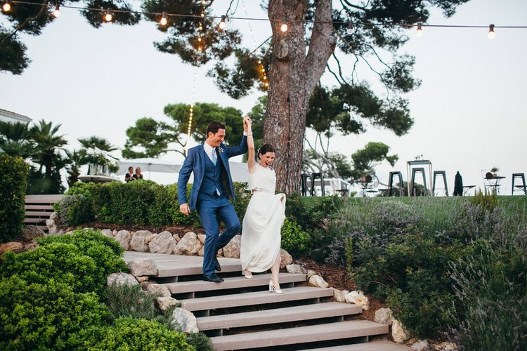 Bride in Verónica Miranda Bridal Separates & Groom in Navy Suit by The Fitters