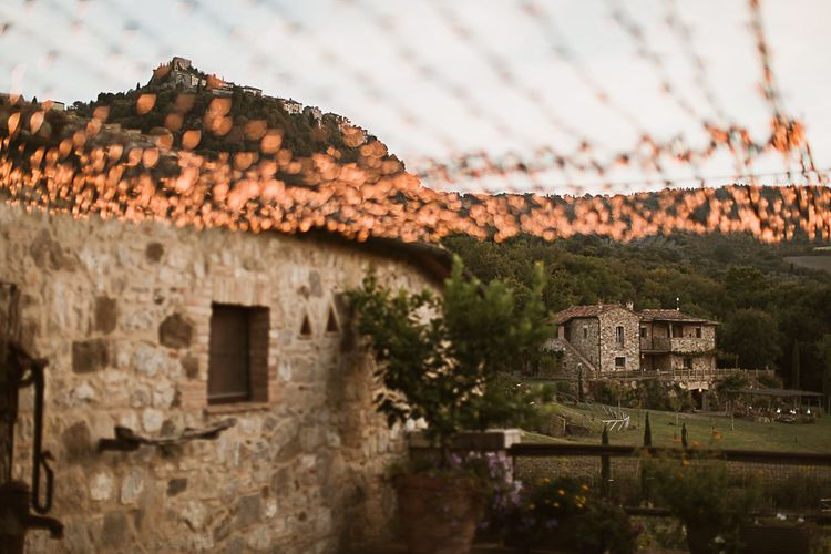 Intimate Tuscan Wedding at WP Relais, Castiglione D'orcia, Siena | Outdoor Reception with Fairy Light Decor | Bride in Gown from Cargie Threads | The Springles Photography