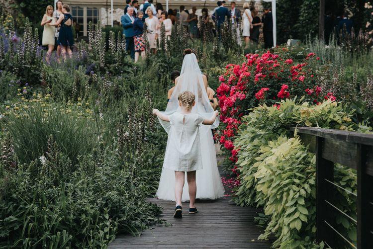 Flower Girl Holding the Brides Veil