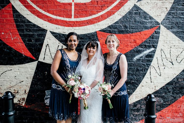 Bridesmaids In Navy Flapper Dresses // Vintage Inspired Wedding With 20s & 30s Influences In London At Shoreditch Studios With Images From Beatrici Photography And Styling By The Barnables