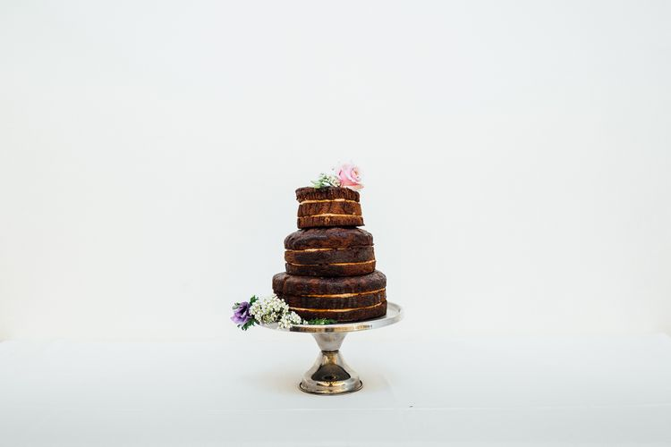 Chocolate Wedding Cake // Vintage Inspired Wedding With 20s & 30s Influences In London At Shoreditch Studios With Images From Beatrici Photography And Styling By The Barnables