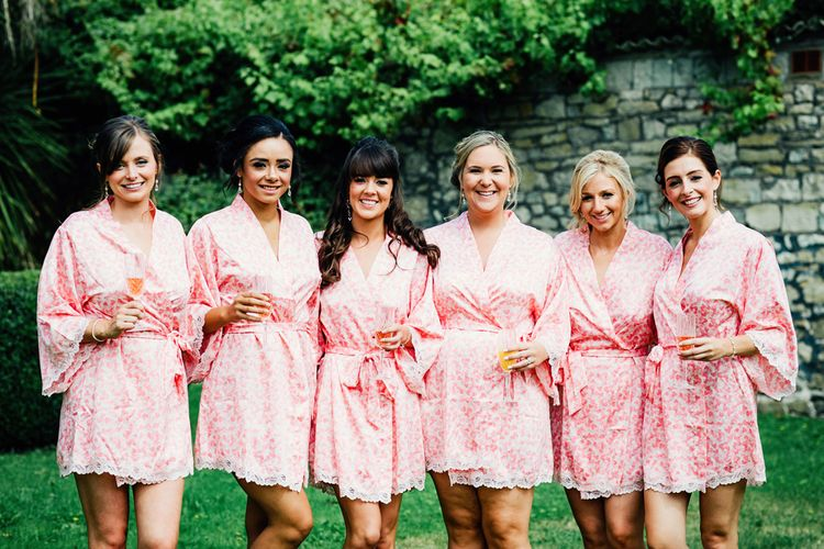 Bridesmaids In Pink Robes | St Donat's Castle Wedding With Pink & Gold Colour Scheme | Images by Steve Gerrard Photography