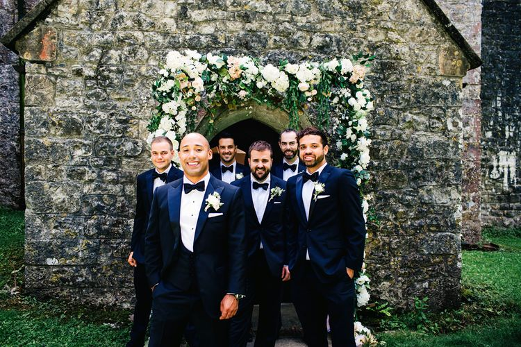 Groom & Groomsmen In Black Tie | St Donat's Castle Wedding With Pink & Gold Colour Scheme | Images by Steve Gerrard Photography