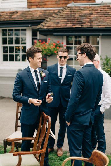 Groom in A Suit That Fits   Groomsmen in Red Herring at Debenhams Suits   M & J Photography   Dan Dolan Films