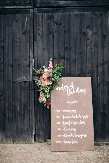 DIY Wooden Order of the Day Sign & Flowers   The Great Barn Rolverden   Joanne Truby Floral Design   M & J Photography   Dan Dolan Films