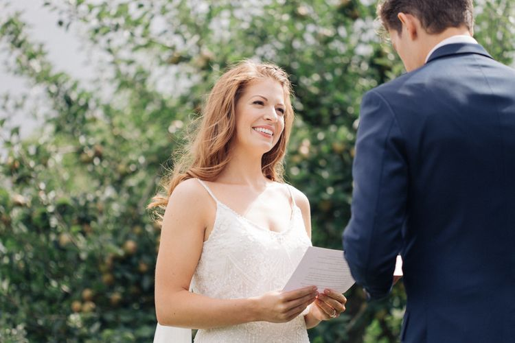 Outdoor Wedding Ceremony at The Great Barn, Rolvenden   Bride in Limor Rose Norma Gown   Groom in A Suit That Fits   M & J Photography   Dan Dolan Films