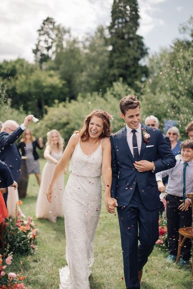 Confetti Moment at The Great Barn, Rolvenden   Bride in Limor Rose Norma Gown   Groom in A Suit That Fits   M & J Photography   Dan Dolan Films
