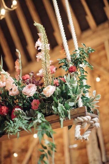 Hanging Floral Installation by Joanne Truby Floral Design   The Great Barn, Rolvenden Wedding   M & J Photography   Dan Dolan Films