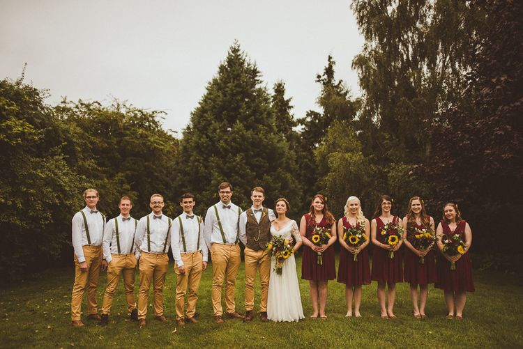 Wedding Party In Yellow Trousers And Red Bridesmaids Dresses