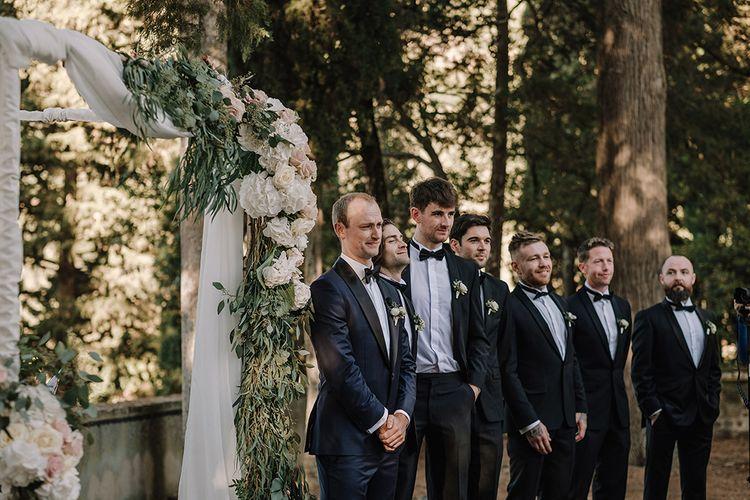 Wedding Ceremony   Groomsmen in Tuxedos   Super Luxe Blush, White & Greenery Destination Wedding at Villa Pitiana, Tuscany, Italy   Jason Mark Harris Photography   Angelo La Torre Film