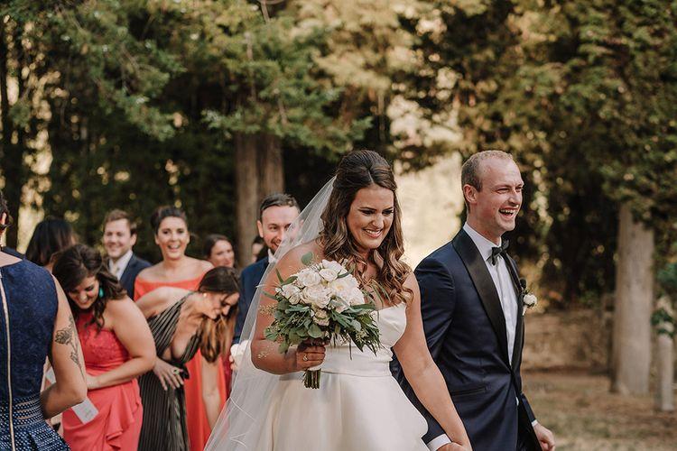 Wedding Ceremony   Bride in Monique Lhuillier Gown   Groom in Tuxedo   Super Luxe Blush, White & Greenery Destination Wedding at Villa Pitiana, Tuscany, Italy   Jason Mark Harris Photography   Angelo La Torre Film