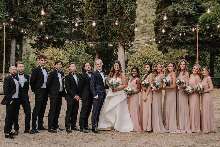Wedding Party   Bride & Bridesmaids in Monique Lhuillier Gowns   Groomsmen in Tuxedos   Super Luxe Blush, White & Greenery Destination Wedding at Villa Pitiana, Tuscany, Italy   Jason Mark Harris Photography   Angelo La Torre Film