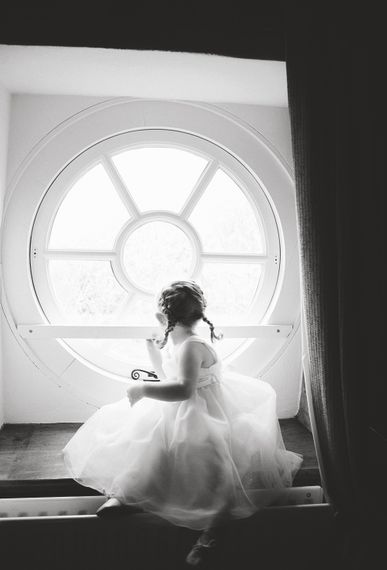 Flower Girl Sitting in the Window