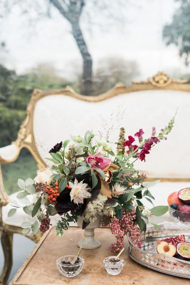 Elegant Sofa & Floral Arrangement | Autumnal Decadence Wedding Inspiration at Twyning Park Styled by For The Love of Weddings | Red, Gold & Blush Colour Scheme | Captured by Katrina Photography