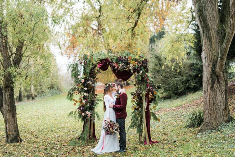 Woodland Floral Arch   Stylish Bride & Groom   Autumnal Decadence Wedding Inspiration at Twyning Park Styled by For The Love of Weddings   Red, Gold & Blush Colour Scheme   Captured by Katrina Photography