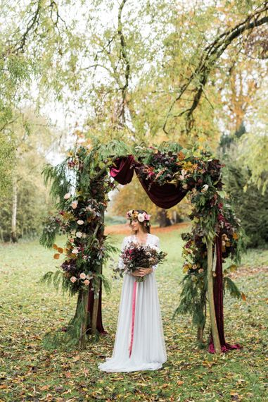 Woodland Floral Arch | Bride in Tulle | Autumnal Decadence Wedding Inspiration at Twyning Park Styled by For The Love of Weddings | Red, Gold & Blush Colour Scheme | Captured by Katrina Photography