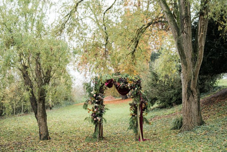 Autumn Floral Arch | Autumnal Decadence Wedding Inspiration at Twyning Park Styled by For The Love of Weddings | Red, Gold & Blush Colour Scheme | Captured by Katrina Photography