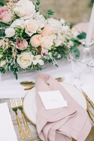 Romantic Table Scape With Roses And Pink Linens