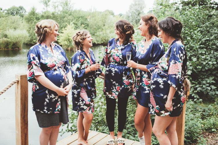 Bridesmaids In Navy Floral Robes