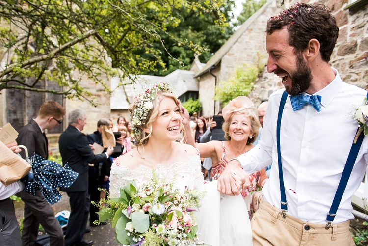 Confetti Moment   Bride in Lace Wedding Dress   Groom in Shorts, Braces & Bow Tie   Coastal Wedding at Driftwood Spas St Agnes, Cornwall   Jessica Grace Photography