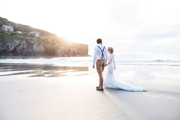 Golden Hour   Bride in Lace Wedding Dress   Groom in Shorts, Braces & Bow Tie   Coastal Wedding at Driftwood Spas St Agnes, Cornwall   Jessica Grace Photography