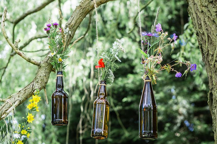 Hanging Brown Bottles with Flower Stems