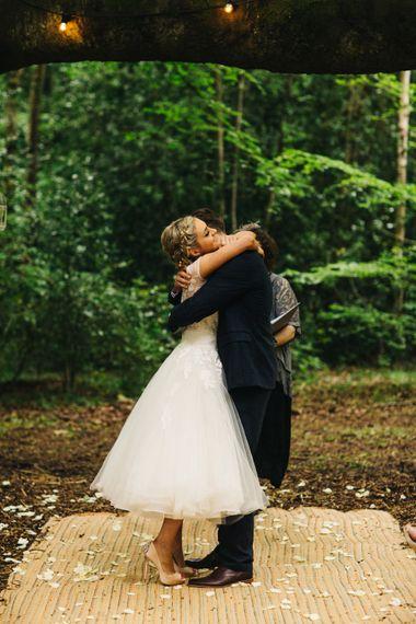 Bride in Short Blue by Enzoani Danbury Gown & Groom in Navy Ted Baker Suit