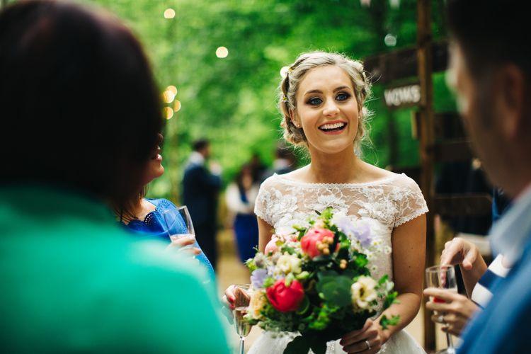 Beautiful Bride with Wild Flower Bouquet