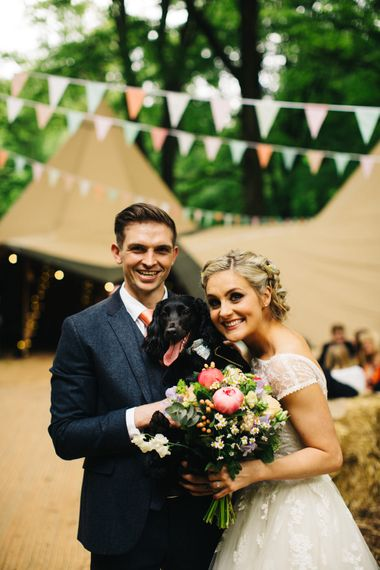 Bride in Short Blue by Enzoani Danbury Gown & Groom in Navy Ted Baker Suit with Pet Dog
